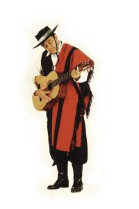Man Wearing Traditional Clothing Playing Guitar