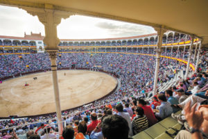 Madrid, Spain - May 11, 2012: Plaza de Toros de Las Ventas interior view with tourists gathered for the bull show in Madrid on a sunny day, Spain