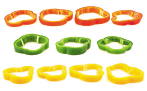 Set of sliced red, green, yellow bell pepper section pieces isolated over white background