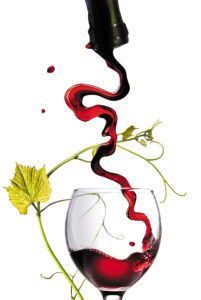 Pouring red wine in glass with rod isolated on white